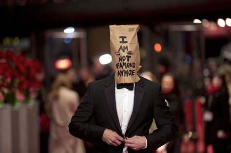 Shia LaBeouf sports paper bag over his head on Berlin red